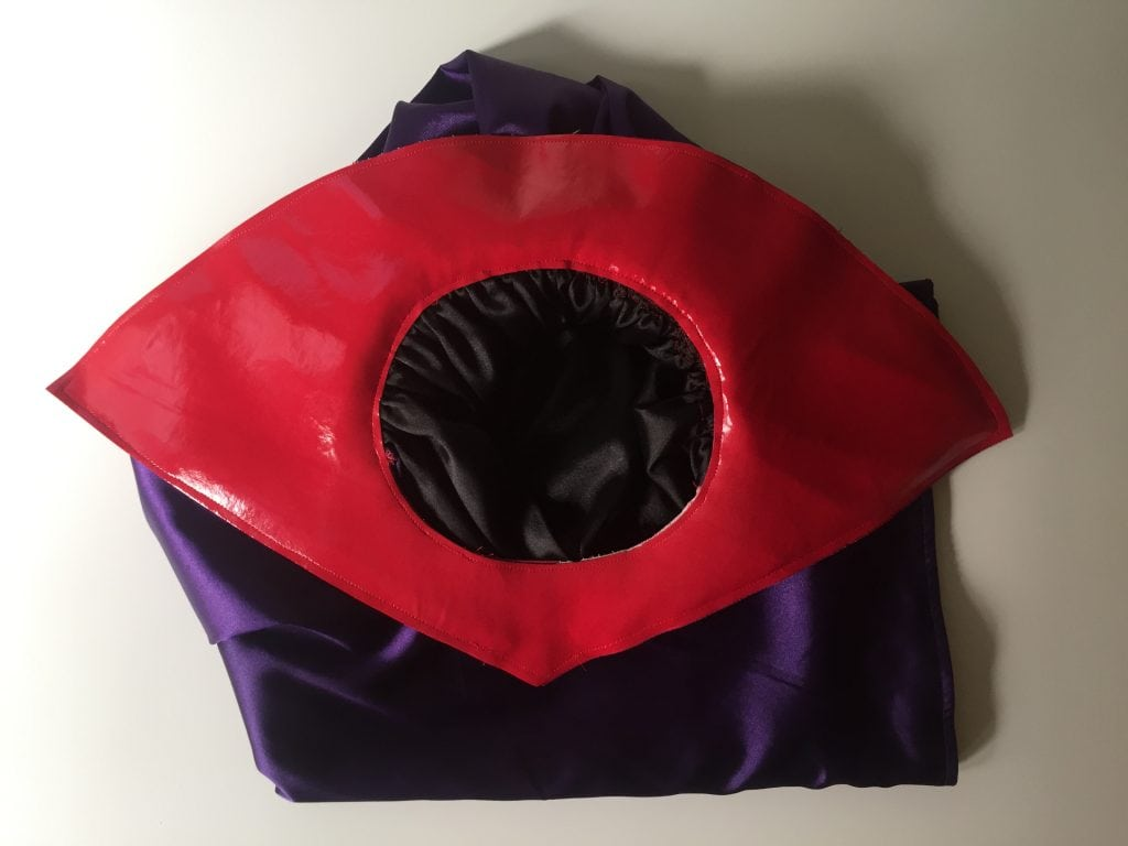 Image of the purple and black cape with a red vinyl collar for the Catra costume