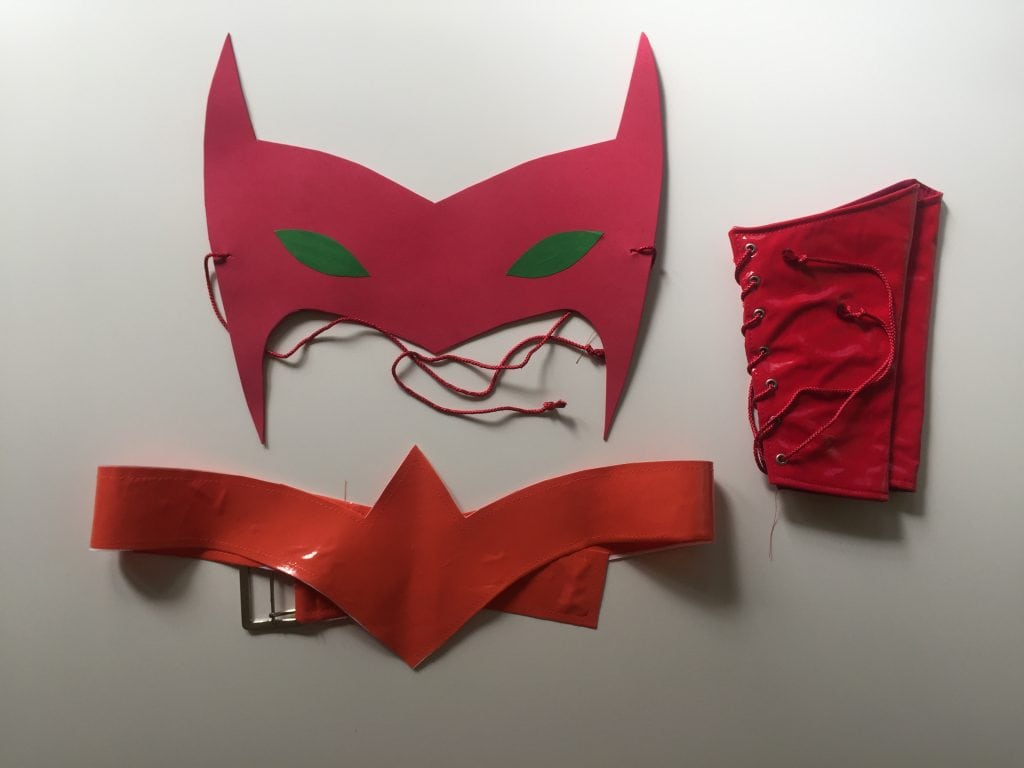 Image of the Catra mask, bracelets, and belt for the Catra costume