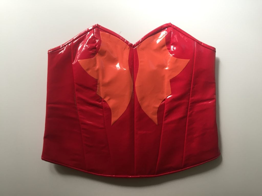 Red PVC corset with orange PVC detail based on Catra's outfit