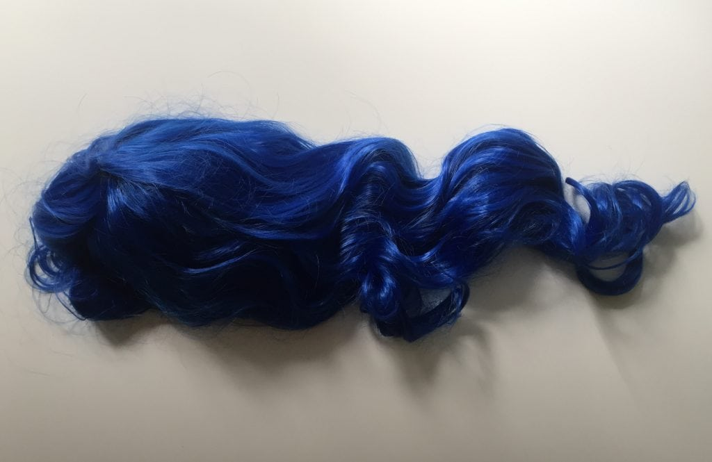 Image of a long blue wig for the Catra costume