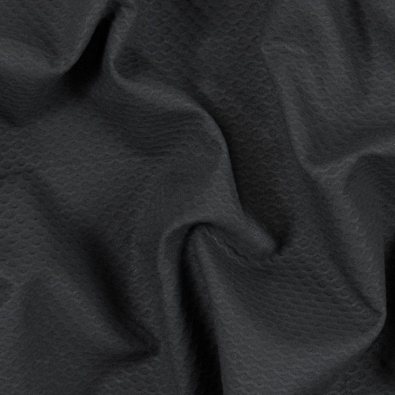 Image of black cotton pique fabric from Mood Fabrics