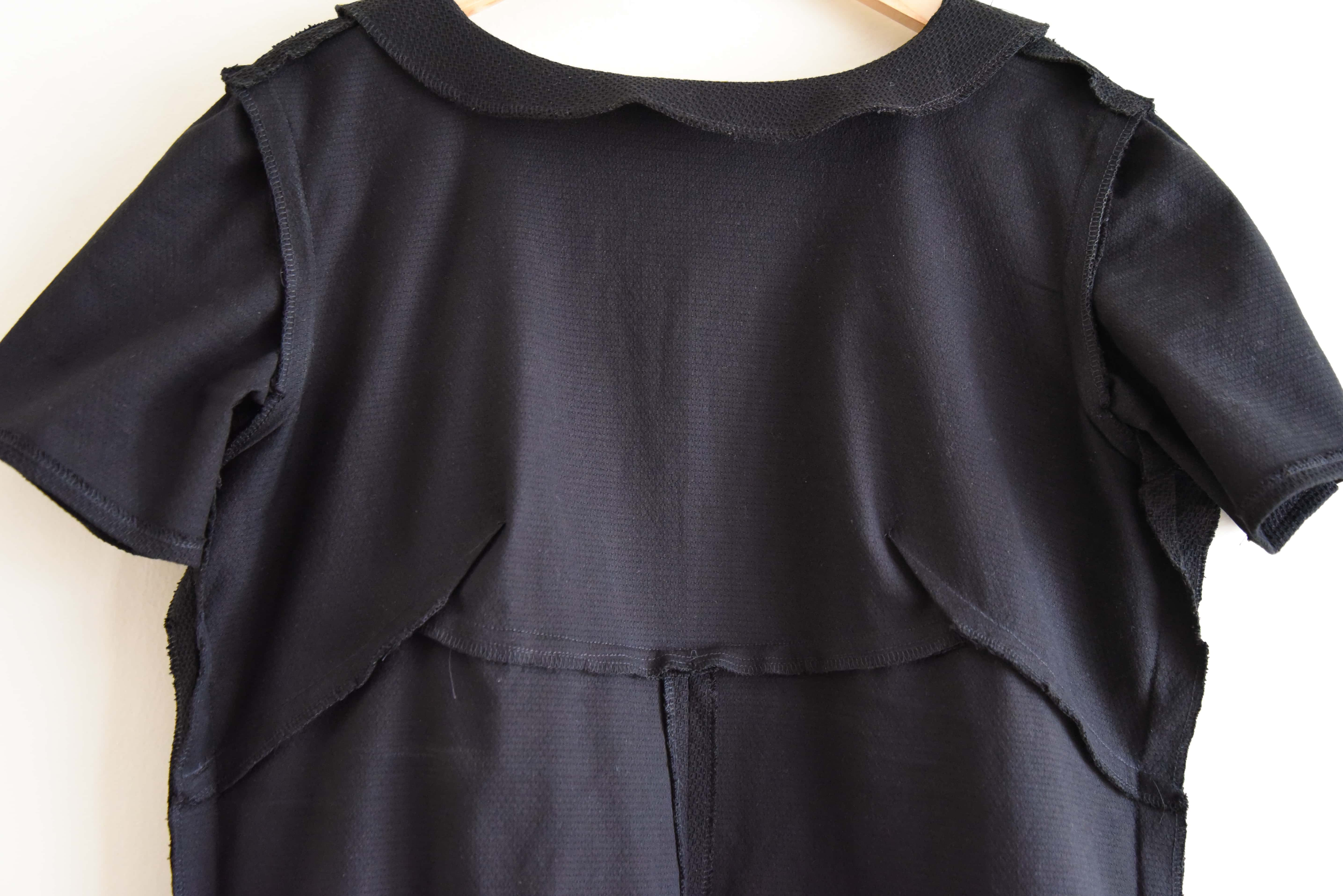 Image of inside of bodice for Simplicity 3833 with seams finished with a serger