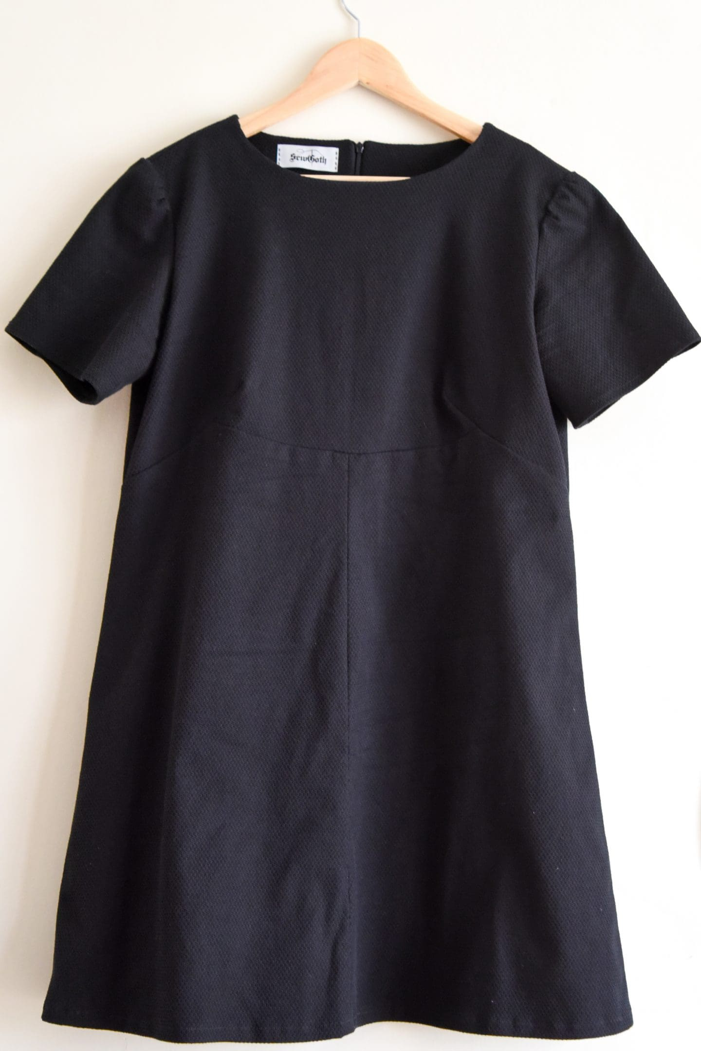 Image of the finished dress on a hanger