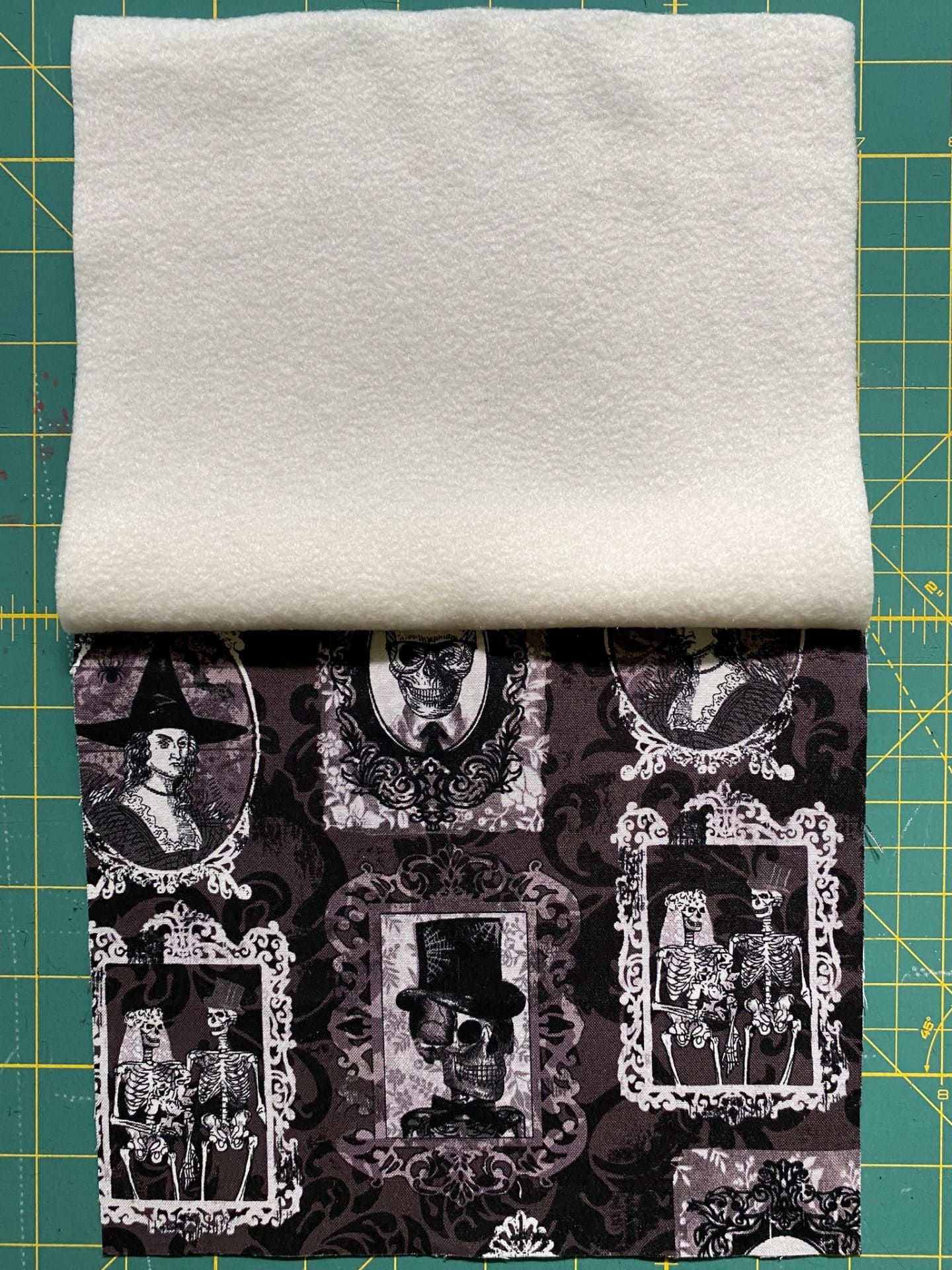 Image of two layers of fabric with top edge sewn.