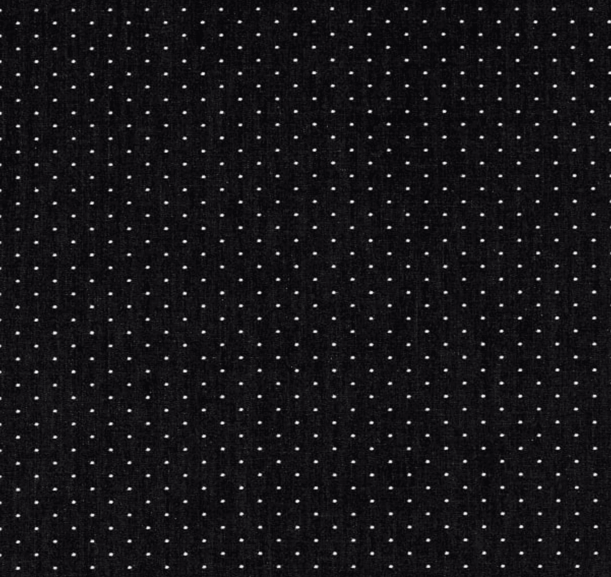 Image of black chambray fabric with white polka dots.