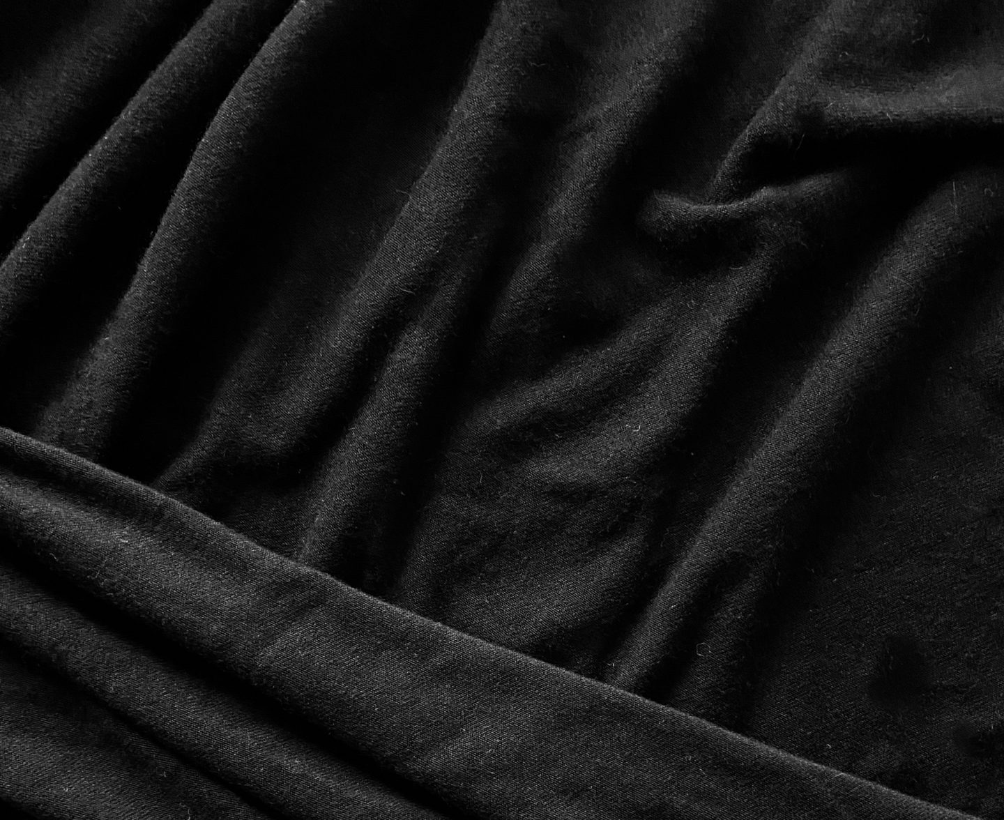 Image of black knit fabric