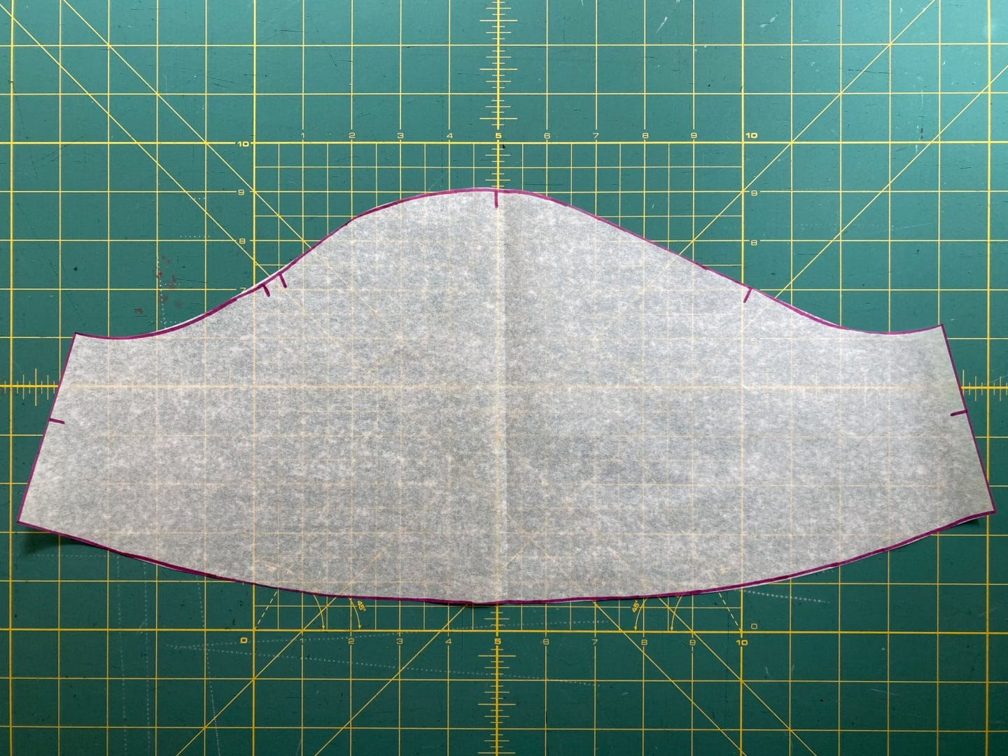 Image of the new sleeve pattern piece showing the curved bottom of the piece.