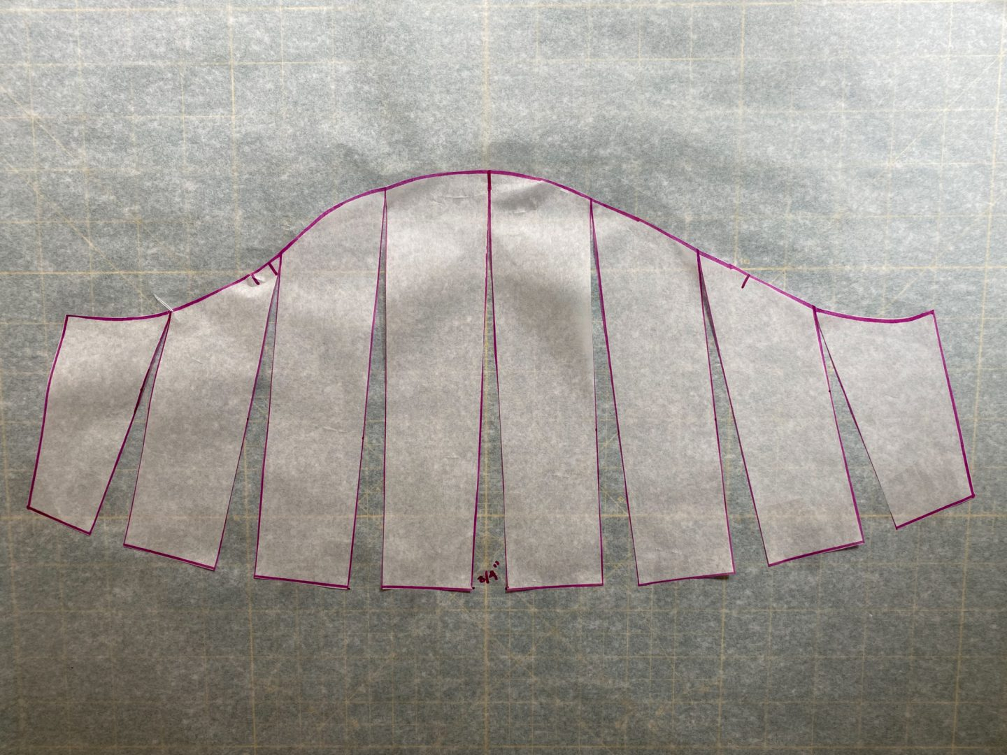 Image of the sleeve piece slashed and taped to a larger piece of paper.