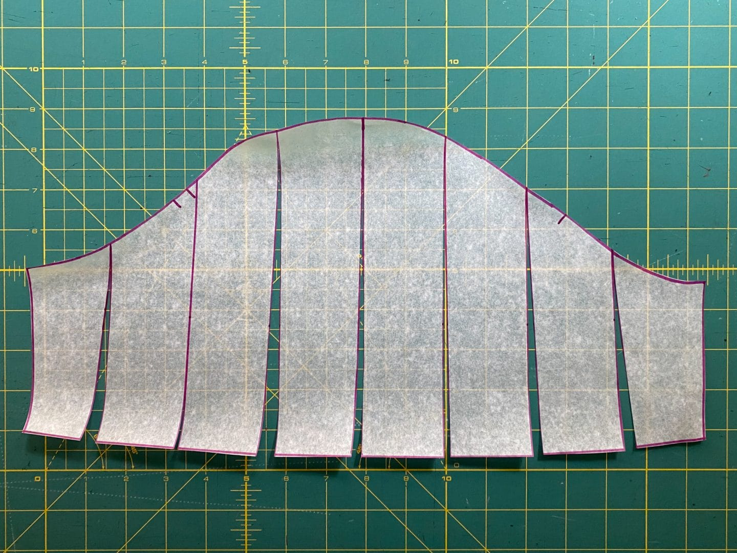 Image of the sleeve pattern showing the pink lines parallel to the grain line cut into the pattern.