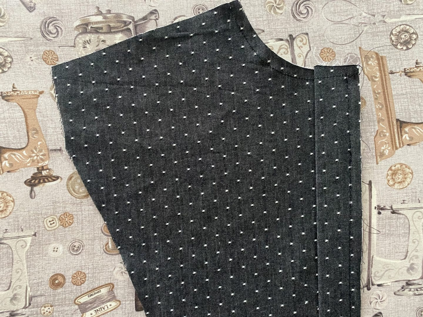 Image of Simplicity 1941 front pattern piece right side up with the second step for the button placket, a fold using the second marking with the fabric folding to outside