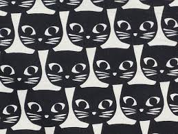 Image of white canvas fabric with black cat face print