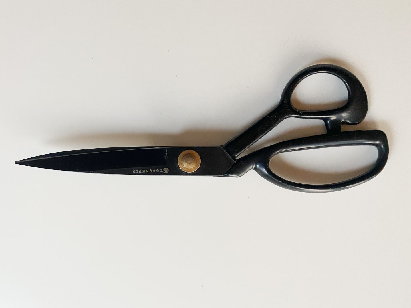Image of a black pair of shears against a white background.