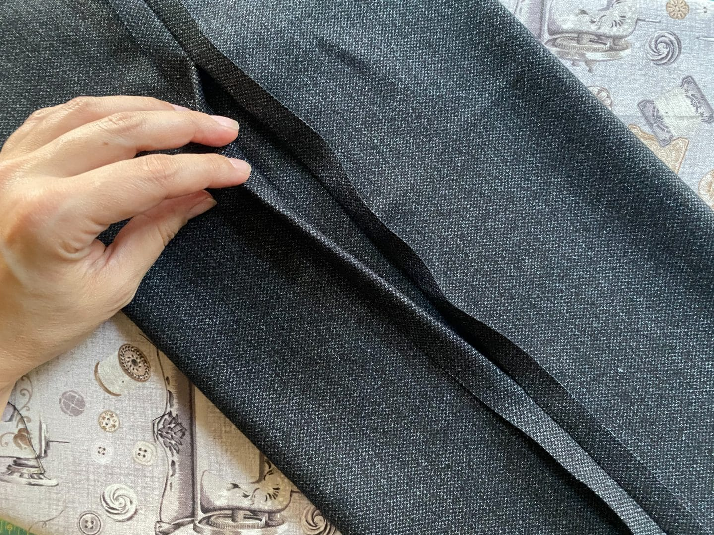 Image of a piece of ponte de roma tweed fabric with an opening on the seam to allow the piece to be turned inside out