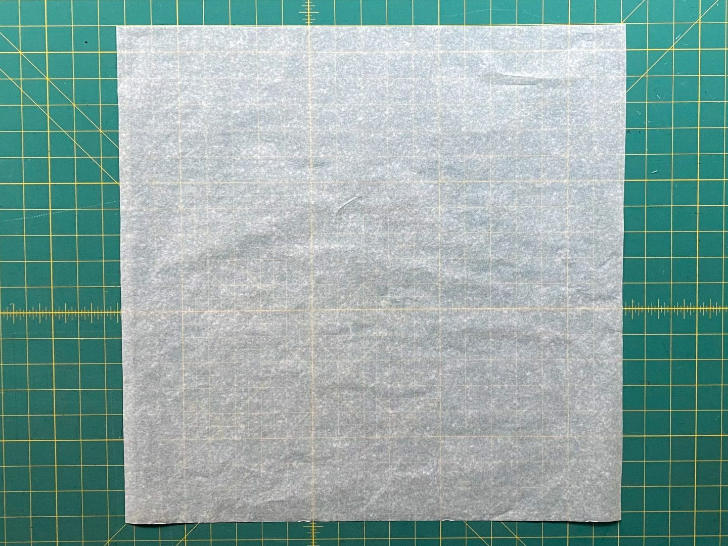 Image of a square of white paper, the pattern for the Piper's Pillow